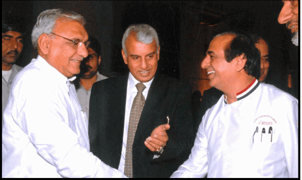 Chef Davinder Kumar is being introduced to former Chief Minister of Haryana, Mr Hooda at Chef Awards function.