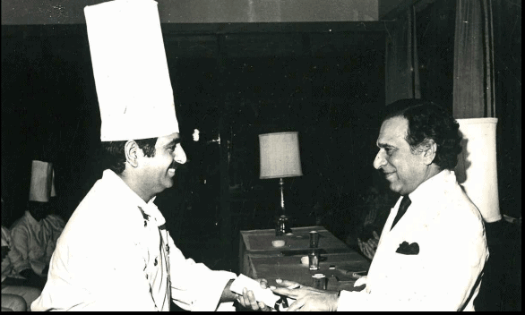 Mr PRS Oberoi(Chairman & Managing Director, Oberoi Hotels) facilitating young Davinder Kumar for completing kitchen management training program with Oberoi hotel in 1975.